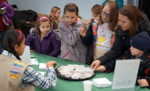 Lexi R. describes the different flavors of Girl Scout Cookies to visitors of our Elgin Service Center.