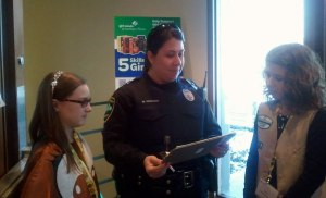 A Sugar Grove Police Officer who is also GSNI Alumnae stopped by the Sugar Grove Service Center and bought some Girl Scout Cookies while talking with Annabelle L. and Emily T.